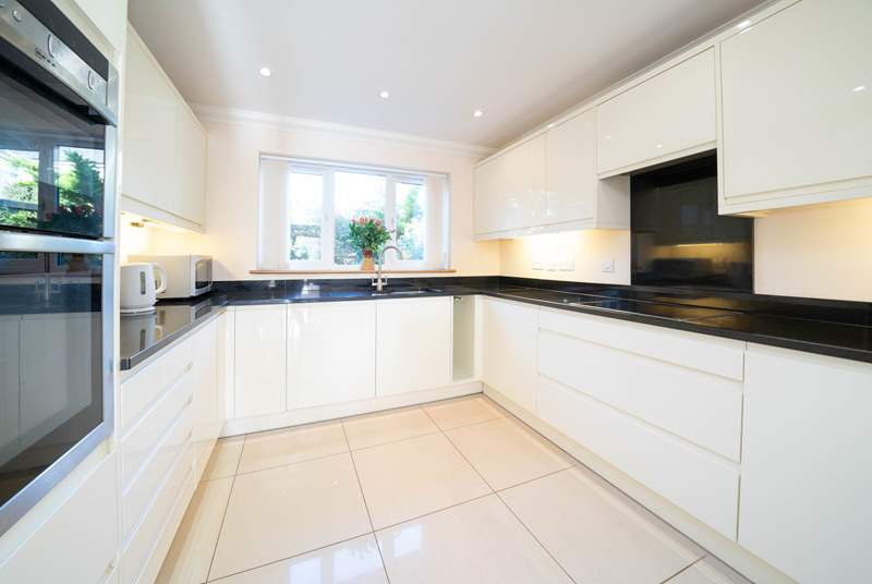 The sleek modern kitchen offers plenty of space to cook up a special family treat!
