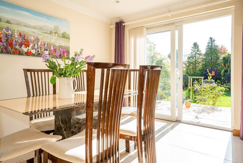The sitting/dining-room leads out to the patio and garden area, ideal for the family to all spread out.