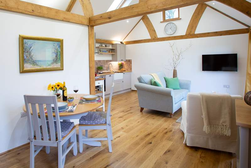 The stylish open plan living area with under-floor heating will keep you cosy whatever the weather.