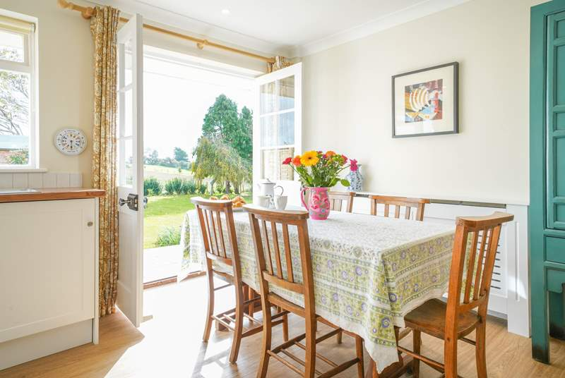 Open the French doors leading out to the garden whilst admiring stunning views across Culver Down.