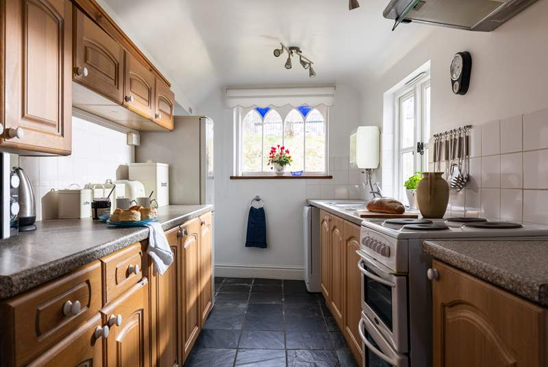 The kitchen floods with light and has wonderful views of the platform. At the end of the kitchen you will find a small utility area and the downstairs WC.