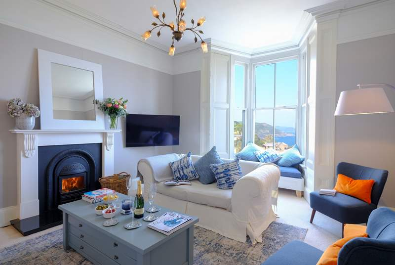 The beautiful sitting-room where you can enjoy harbour views at any time of year. Please note the fire is ornamental only.