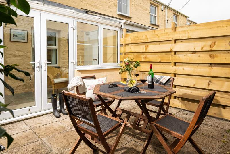 The sunny patio, and the cottage entrance through the conservatory.