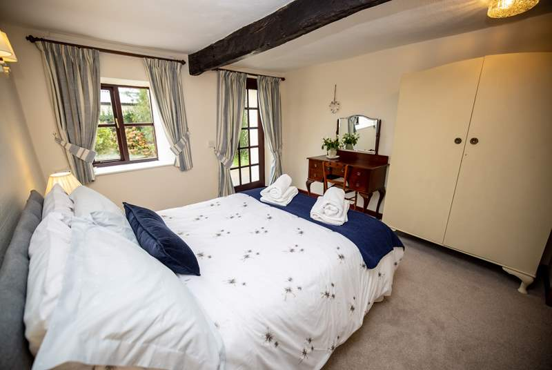 The downstairs double bedroom offers a ground floor option with a bathroom also on this level.  Please note the door gives you access to the back garden.