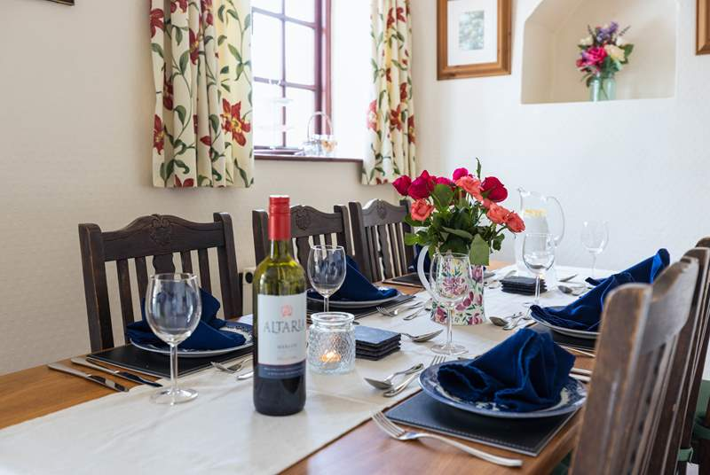 The dining table sits to the side of the fully equipped Kitchen.