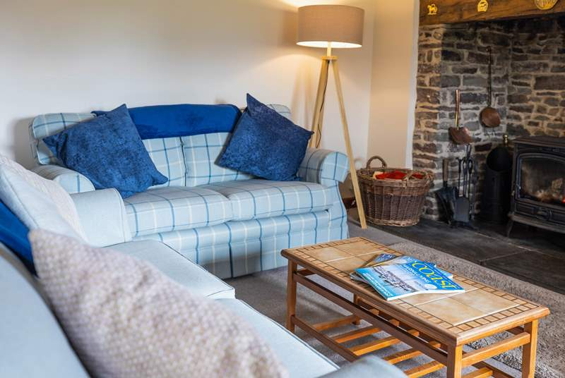 The sitting-room sits to the back of the house, with views and a back door out to the garden. The crowning glory has to be the wonderful log-burner that will keep everyone toasty.