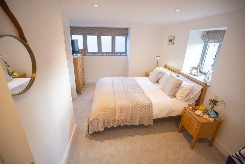 The main bedroom is both spacious and tranquil with neutral tones offering a calming place to rest up and recharge.