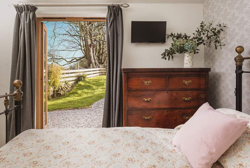 The main bedroom is located on the ground floor, and overlooks the garden.