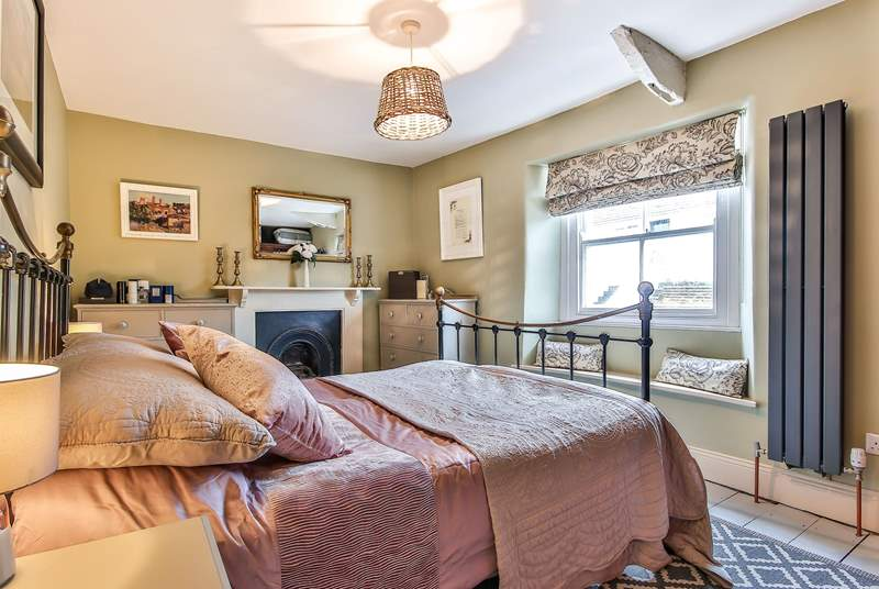 The main bedroom sits to the front of the house and offers a luxurious place to recharge and relax.