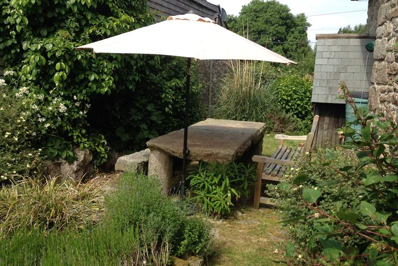 The kitchen leads into the fully enclosed garden. A great spot to enjoy a glass of something tasty.