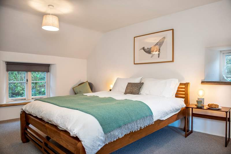 The cottage has two pretty bedrooms.