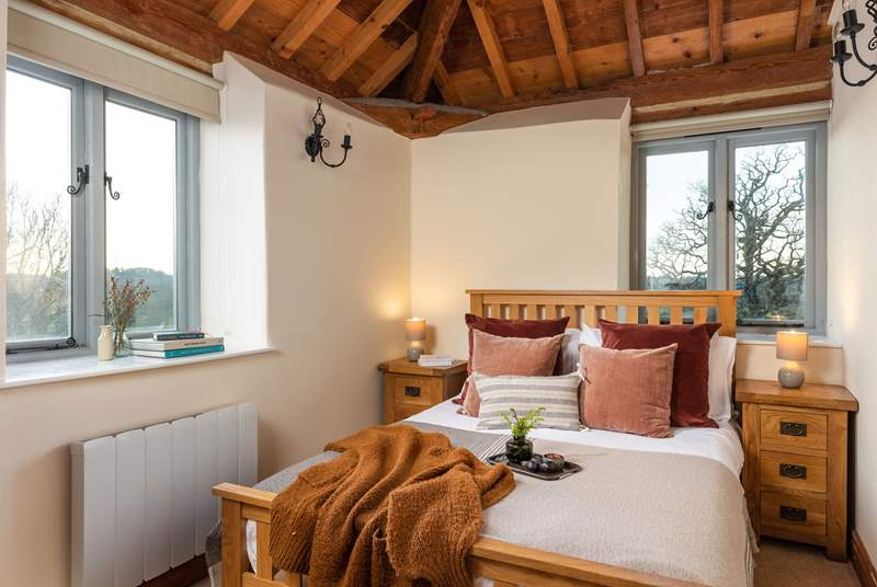 The main bedroom has a wonderful vaulted ceiling and has a fabulous en suite bathroom with a heated towel rail.