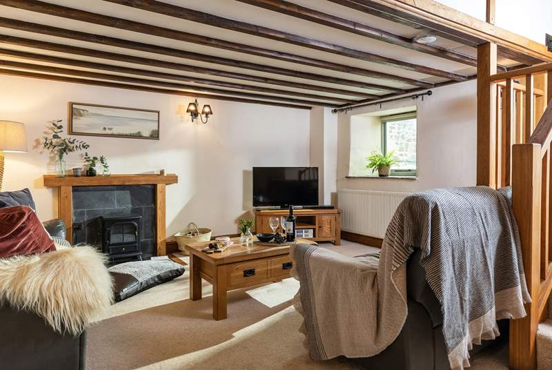 The sitting-area is a cosy corner for all the family to enjoy and keep warm around the electric log-burner.