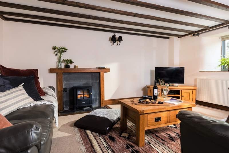 The living-room is warm and welcoming and situated on the lower floor of this beautifully converted barn.