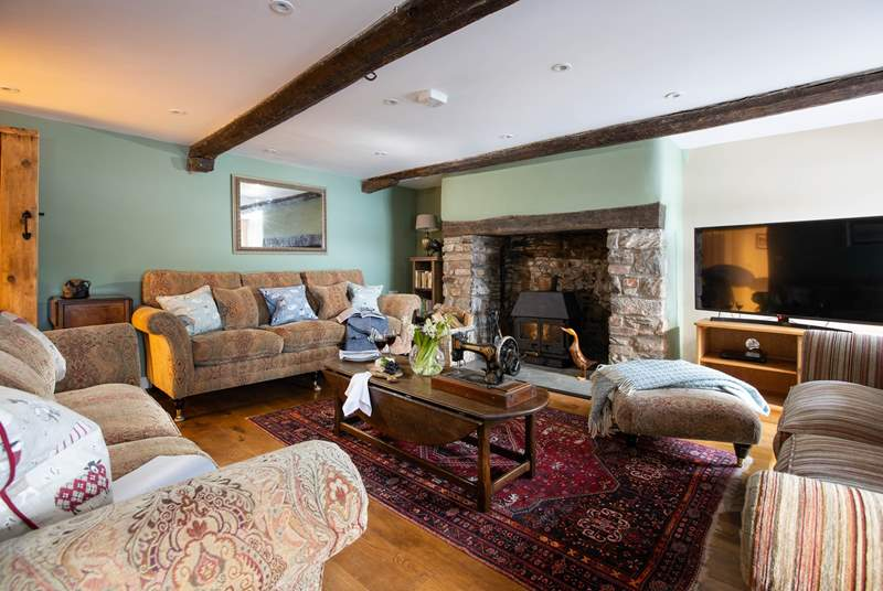 The fabulous sitting-room features a wood-burner to keep you toasty on those cooler days and evenings.