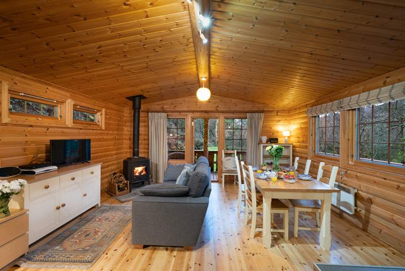 Lovely open plan living space with wood-burner.
