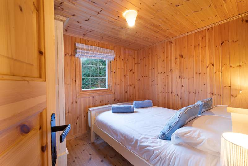 Bedroom 2, a double room with pretty woodland view.