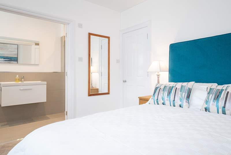 The stunning main bedroom on the first floor with an en suite shower-room.