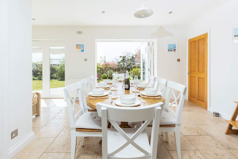 The fabulous kitchen/diner floods with light from the patio doors that open out into the landscaped gardens.