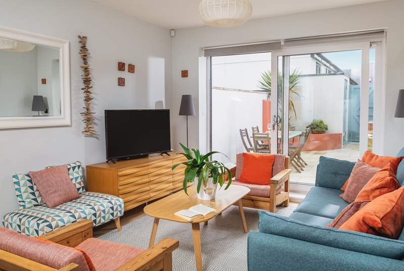 The open plan living-room is bright and light.