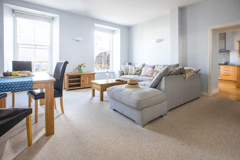 The light and bright living space has views over the water sports centre and to the sea beyond.