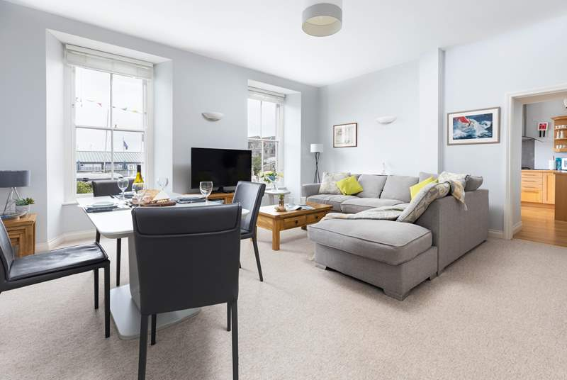 The stylish sitting room is ever so comfortable, enjoy looking out towards the docks and sea at the ever changing view.