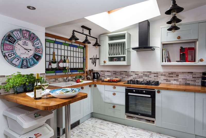 The light and airy kitchen is the perfect place for cooking up a feast with the local catch of the day.