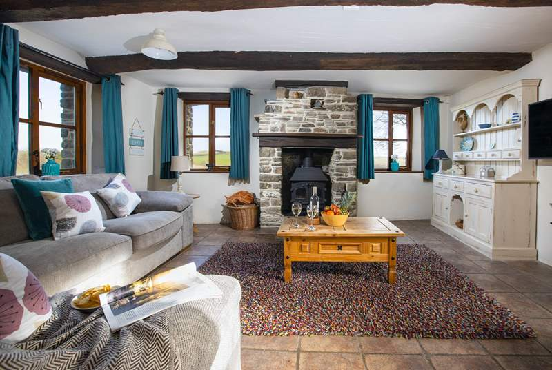 Get comfortable in front of the cosy wood-burner.