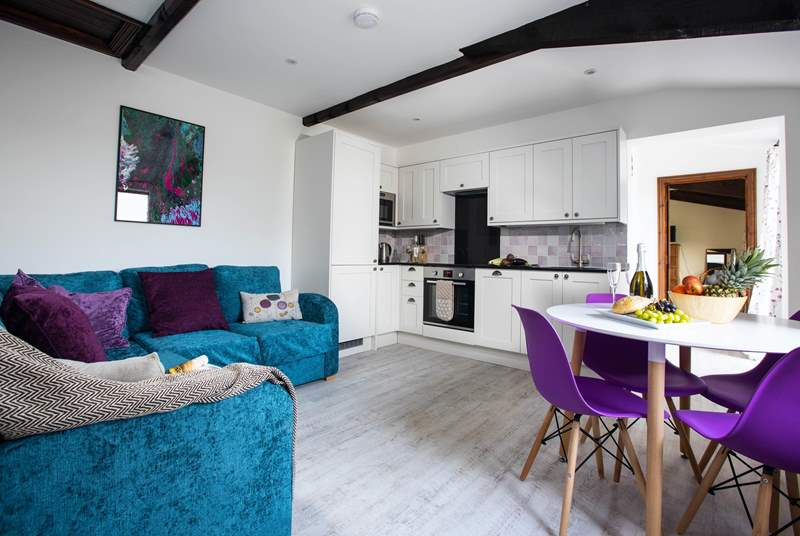 The open plan living-room is a bright and comfortable space.