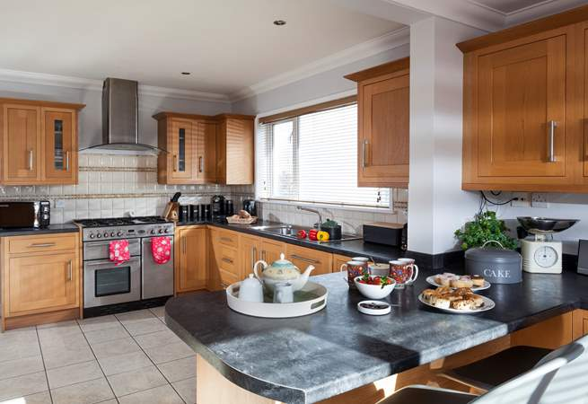 The stylish kitchen with room to cook and room to dine at the breakfast-bar.