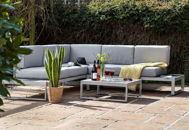 Comfy seating perfect for relaxing in the garden after a day out exploring.