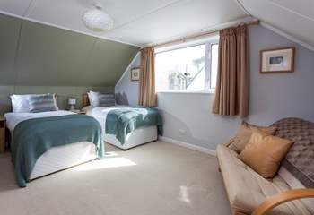 Twin beds in this spacious bedroom.