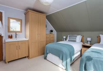 This bedroom has plenty of storage and a handy bedroom sink.