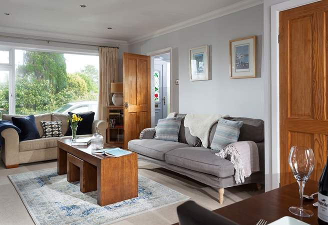 Comfy sofas and quality furnishings surround you.