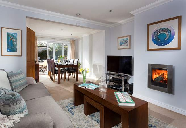 The cosy and comfy sitting-area leads through to the dining-area which overlooks the garden.