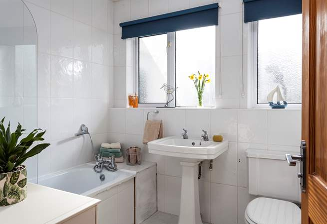 A lovely light bathroom for a soak in the tub.