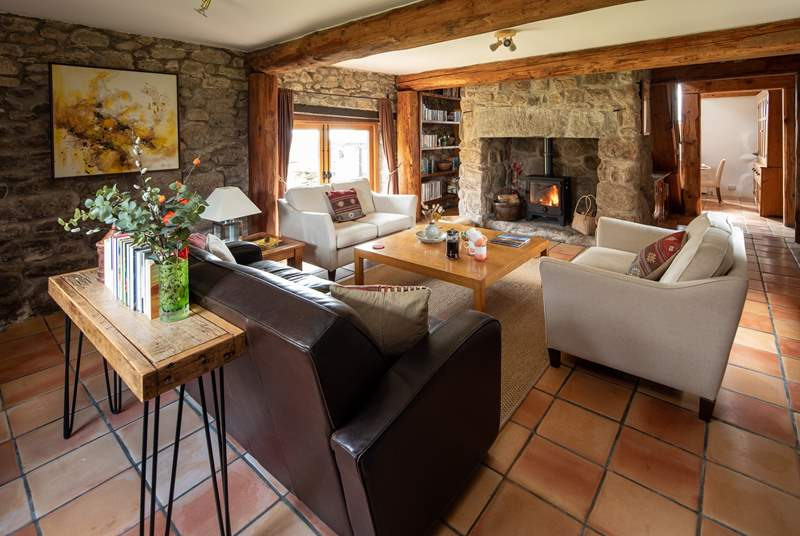 The fabulous sitting-room with glowing wood-burning stove. Perfect for snuggling up in after a full day of exploring.