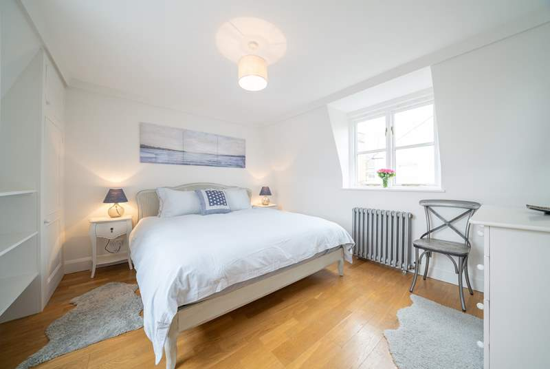 The light and spacious main bedroom on the first floor with sea views.