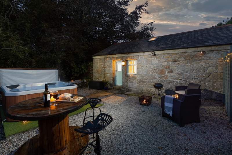 Watch the stars from your hot tub or toast marshmallows on the firepit.