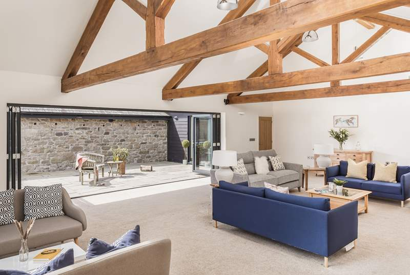 As you would expect in such a fabulous house, there is plenty of space for relaxing. The more formal lounge to the front of the house is magnificent with a wood-burner.