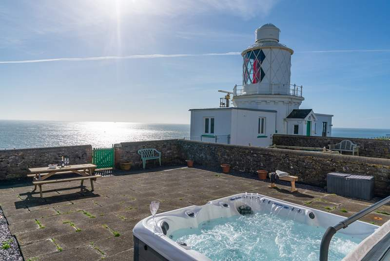Spend blissful hours relaxing in the luxurious hot tub surrounded by the sound of the sea.