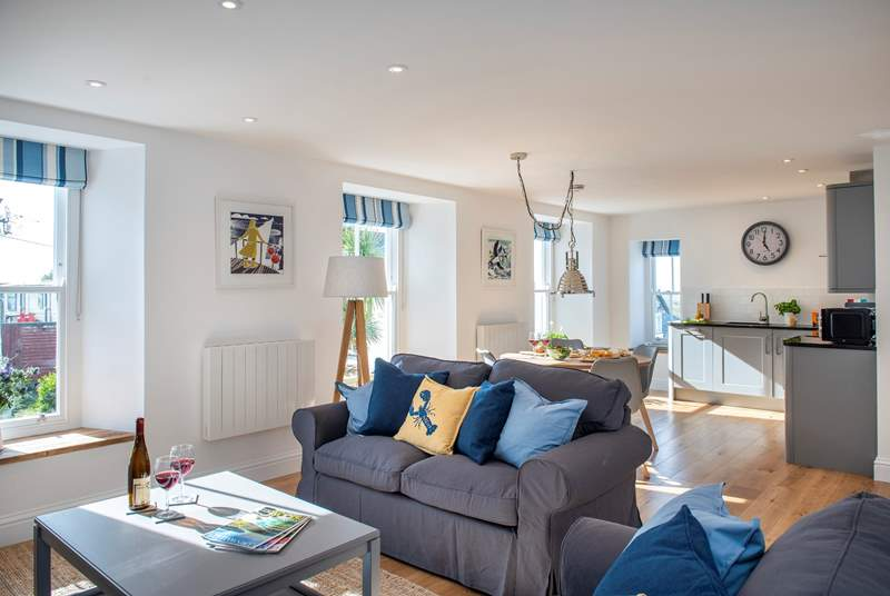 The open plan living-room is wonderfully light and airy, you'll enjoy your time together.