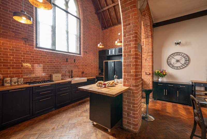 The modern style kitchen adapts well with the historic building.