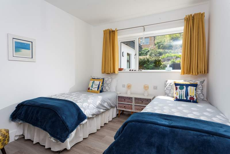 The bedroom has a lovely nautical vibe to it.