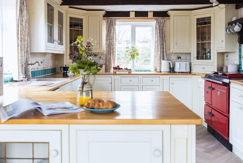 The heart of this cottage has to be this beautiful kitchen which enjoys the benefit of an oil-fired range cooker.