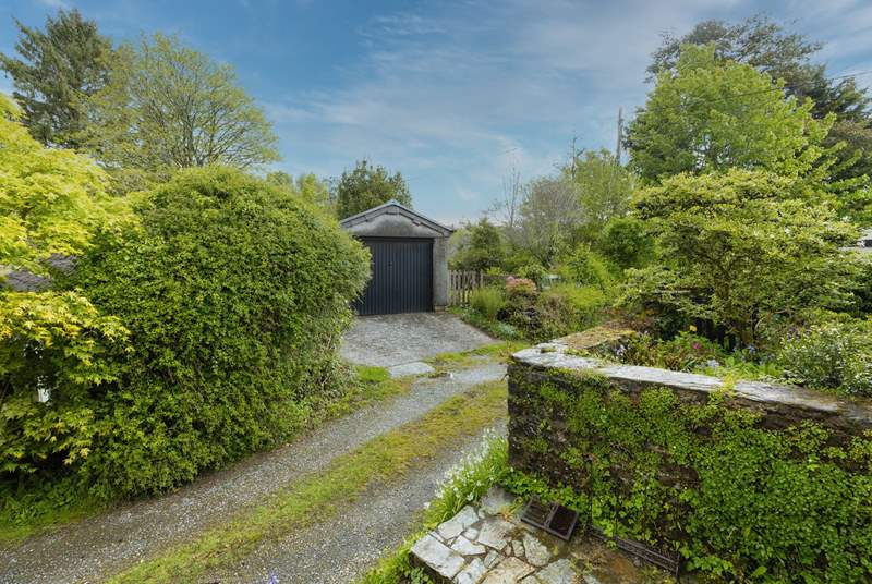 From your doorstep, looking over to the garage and the access to the garden.