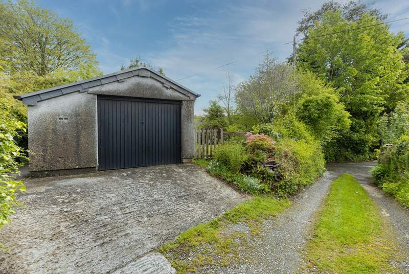 Your garage and sloped parking. Note, the driveway and parking space are recommended for small to medium cars only (due to the width of the approach and space).