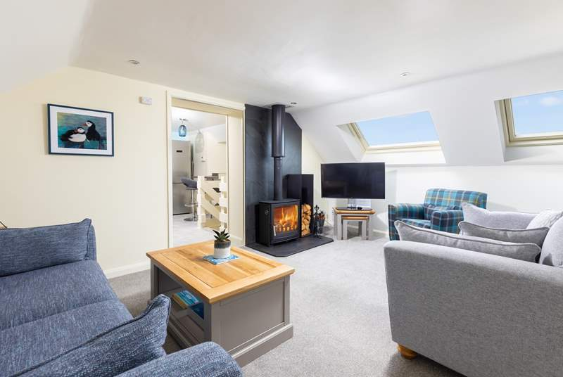 The sitting-room boasts a wood-burner, perfect for those cosy nights in.