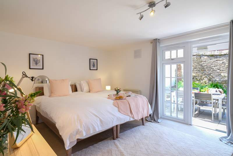 The delightful en suite bedroom on the ground floor with secluded patio.