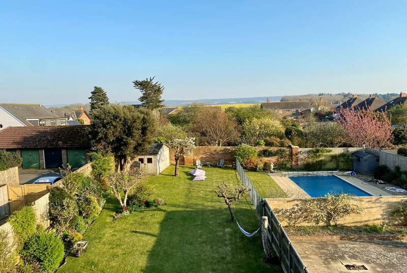 Elmscott showcases a stunning large garden with the wonderful advantage of a outside heated swimming pool.